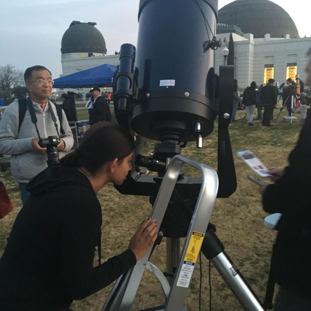 looking through a telescope at Griffith Oberservatory